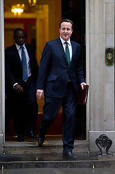 © London News Pictures. 18/03/2013 . London, UK.  British Prime Minister DAVID CAMERON leaving   Downing Street the three main political parties said they had reached a deal on press regulation. Photo credit : Ben Cawthra/LNP