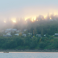 Dawn breaks over Puget Sound while on a fishing trip for coho salmon, near Edmonds, Washington. Photo by William Byrne Drumm.