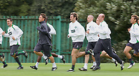 Celtic training at Barrowfield today as manager Gordon Strachan prepares for his first game in the Scottish Premier League against Motherwell tomorrow.<br /> Pic Ian Stewart  Friday July 29th. 2005<br /> Paul Telfer and Alan Thompson lead the squad at training today