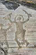 Petroglyph, rock carving, of a warrior  wearing a helmet and carrying a sword and shield. Carved by the ancient Camuni people in the iron age between 1000-1600 BC. Rock no 24,  Foppi di Nadro, Riserva Naturale Incisioni Rupestri di Ceto, Cimbergo e Paspardo, Capo di Ponti, Valcamonica (Val Camonica), Lombardy plain, Italy .<br /> <br /> Visit our PREHISTORY PHOTO COLLECTIONS for more   photos  to download or buy as prints https://funkystock.photoshelter.com/gallery-collection/Prehistoric-Neolithic-Sites-Art-Artefacts-Pictures-Photos/C0000tfxw63zrUT4<br /> If you prefer to buy from our ALAMY PHOTO LIBRARY  Collection visit : https://www.alamy.com/portfolio/paul-williams-funkystock/valcamonica-rock-art.html