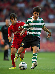 LIVERPOOL, ENGLAND - Wednesday, August 17, 2011: Sporting Clube de Portugal's Joao Teixeira in action against Liverpool's 'Suso' Jesus Fernandez Saez during the first NextGen Series Group 2 match at Anfield. (Pic by David Rawcliffe/Propaganda)