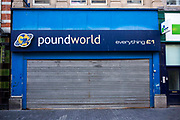 Shop front of Poundworld pound shop in Middlesborough town centre, North Yorkshire, United Kingdom.  The shop is closed and has the security shutters down.   There has been a dramatic increase in the number of pound shops across Britain, especially in poor and deprived areas.  All stock is priced one pound and offers amazing value.