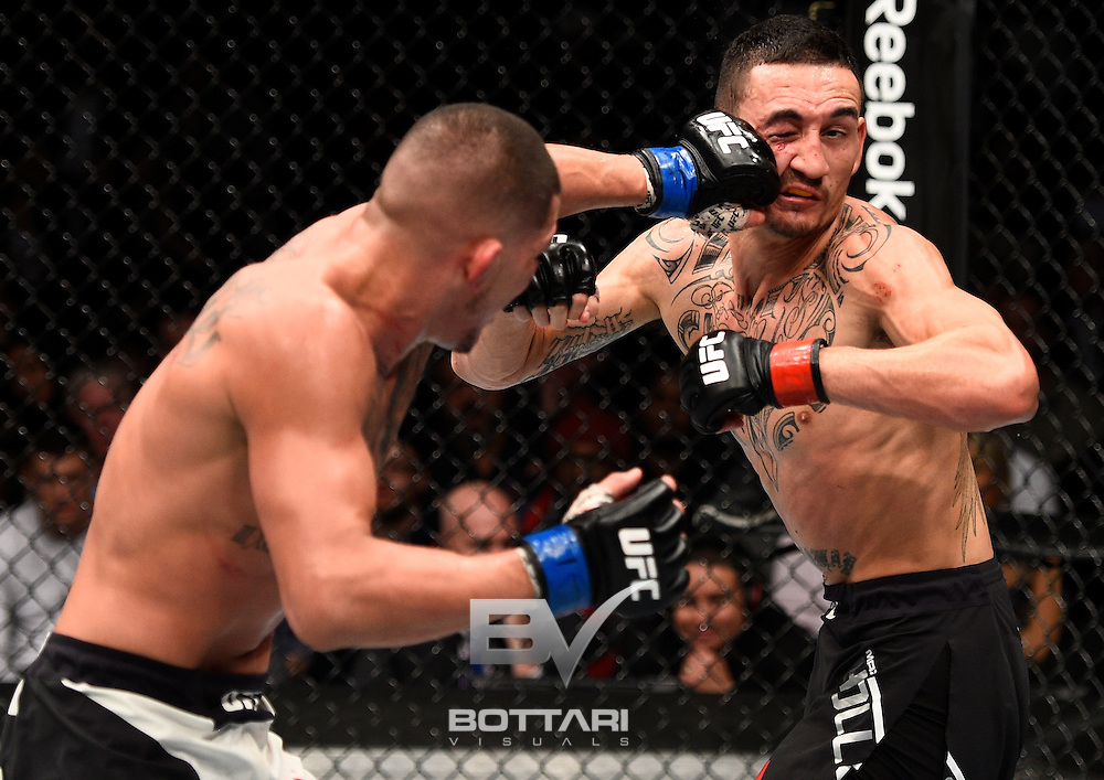 TORONTO, CANADA - DECEMBER 10:  (L-R) Anthony Pettis punches Max Holloway in their interim UFC featherweight championship bout during the UFC 206 event inside the Air Canada Centre on December 10, 2016 in Toronto, Ontario, Canada. (Photo by Jeff Bottari/Zuffa LLC/Zuffa LLC via Getty Images)