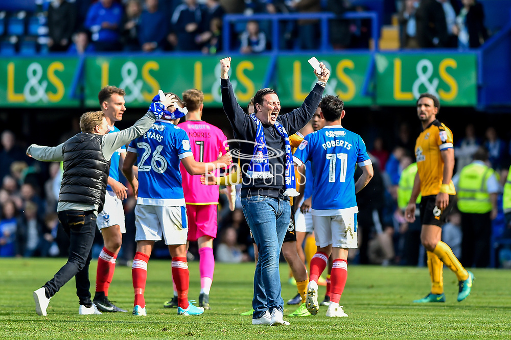 Portsmouth fan on the pitch at the final whistle during the EFL Sky Bet League 2 match between Portsmouth and Cambridge United at Fratton Park, Portsmouth, England on 22 April 2017. Photo by Adam Rivers.