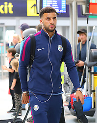 Kyle Walker as the Manchester City team arrive at Manchester Airport as they jet for Iceland