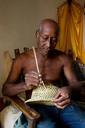 Caribbean, Cuba, Trinidad, man weaving straw hat