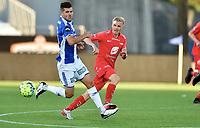 Fotball , 02. juli 2020 , Eliteserien  ,  Sarpsborg - Brann<br /> Taijo Teniste  , Brann <br /> Joachim Thomassen , S08
