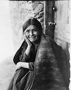 Smiling Native North American Indian woman. Photograph by Edward Curtis (1868-1952).