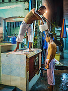 20 OCTOBER 2015 - YANGON, MYANMAR: A Shia men perform ablutions before firewalking for Ashua at Punja Mosque in Yangon. Ashura commemorates the death of Hussein ibn Ali, the grandson of the Prophet Muhammed, in the 7th century. Hussein ibn Ali is considered by Shia Muslims to be the third imam and the rightful successor of Muhammed. He was killed at the Battle of Karbala in 610 CE on the 10th day of Muharram, the first month of the Islamic calendar. According to Myanmar government statistics, only about 4% of the population is Muslim. Many Muslims have fled Myanmar in recent years because of violence directed against Burmese Muslims by Buddhist nationalists.   PHOTO BY JACK KURTZ