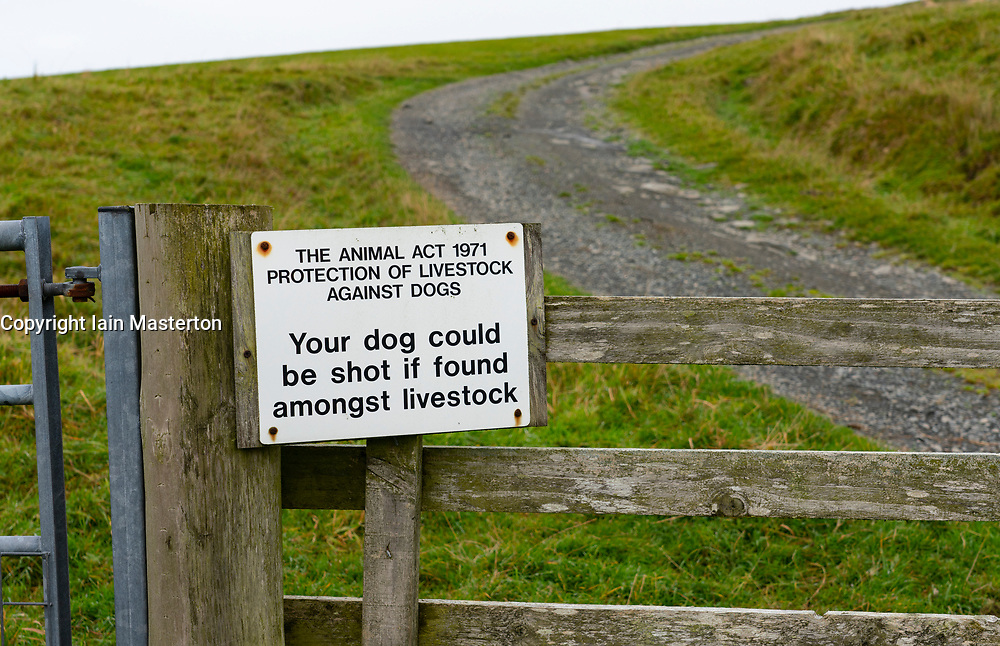 Sign warning that dogs must be kept under control on field gate in North Roe, Shetland, Scotland, UK