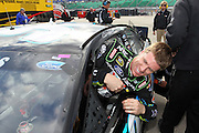 Carl Edwards smiles as he exits his car after his qualifying run for a NASCAR Sprint Cup Series race at Kansas Speedway, Friday, April 19, 2013 in Kansas City, Kansas. (AP Photo/Colin E. Braley)