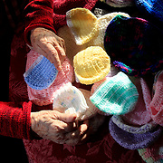 JoHanna Schwind, 90, with some of the hats she has crocheted at her home in Delta, Ohio, on Wednesday, January 17, 2018. Schwind has mostly made them for Toledo's newborn babies and homeless, and funds it all with her own money. She donates the hats. THE BLADE/KURT STEISS
