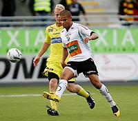 Fotball <br /> Adeccoligaen<br /> AKA Arena , Hønefoss <br /> 12.07.09<br /> Hønefoss BK  v  Moss FK  6-0<br /> <br /> Foto: Dagfinn Limoseth, Digitalsport<br /> Lars Martin Engedal , Mossog Kamal Saaliti , Hønefoss