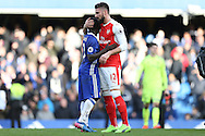 Olivier Giroud of Arsenal hugs Ngolo Kante of Chelsea after the final whistle. Premier league match, Chelsea v Arsenal at Stamford Bridge in London on Saturday 4th February 2017.<br /> pic by John Patrick Fletcher, Andrew Orchard sports photography.