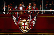Above the city crest, the new Lord Mayor of London waves to crowds during the annual ceremony of the Lord Mayor's Show