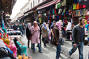 Young Muslim girl with veil scarf using smartphone in The Grand Bazaar, Kapalicarsi, great market in Istanbul, Turkey