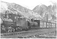 """RGS 2-8-0 #13 with off-center Continental No. 7 tank car and D&RG reefer #35.<br /> RGS  Telluride, CO  Taken by Virden, Walter<br /> In book """"Southern, The: A Narrow Gauge Odyssey"""" page 94<br /> See RD155-126 for original."""