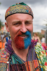 Man with a dyed blue and red beard at the WOMAD (World of Music; Arts and Dance) Festival in reading; 2005,