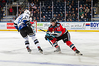 KELOWNA, BC - NOVEMBER 6: Brandon Cutler #29 of the Victoria Royals tries to put the puck around Jake Lee #21 of the Kelowna Rockets during first period at Prospera Place on November 6, 2019 in Kelowna, Canada. (Photo by Marissa Baecker/Shoot the Breeze)