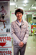 Portrait of a store clerk selling mobile phones in the Daegu Metropolitan City which is the third largest metropolitan area in South Korea.