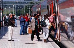 Passengers boarding train at Sitges railway station; Catalonia Catalunya,