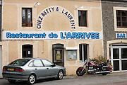 Renault Laguna saloon car and Honda Valkyrie motorcycle at Restaurant de l'Arrivee, in Normandy, France