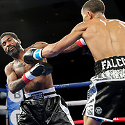 Ofacio Falcon (R) fights Jonathan Gray during a One For All Promotions boxing event at the Caribe Royale Orlando Events Center on Saturday, February 20, 2021 in Orlando, Florida. (Alex Menendez via AP)