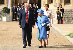 Queen Elizabeth II, US President Donald Trump and first lady Melania Trump walk in the Quadrangle during a ceremonial welcome at Windsor Castle, Windsor.