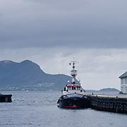 Three weeks aboard the Kong Harald. Hurtigruten, the Coastal Express. A tug boat in Alesund Harbour
