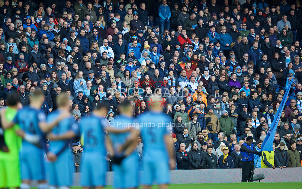 MANCHESTER, ENGLAND - Saturday, November 5, 2016: Manchester City players and supporters stand to remember those that gave their lives in the Great War, before the FA Premier League match against Middlesbrough at the City of Manchester Stadium. (Pic by David Rawcliffe/Propaganda)