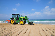 Tractor cleans the beach. Photographed in Haifa, Israel