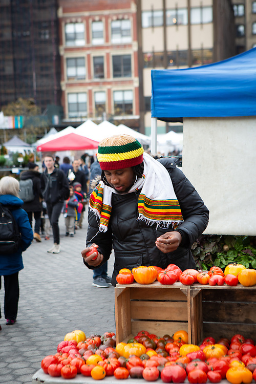 New York, NY - December 14, 2018: At the Union Square Greenmarket with Chef Troy Levy, a Rastafarian chef specializing in Ital cuisine.<br /> <br /> Photos by Clay Williams for Island & Spice.<br /> <br /> © Clay Williams - http://claywilliamsphoto.com