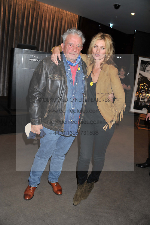 DAVID BAILEY and KATE MOSS at the launch of Samsung's NX Smart Camera at charity auction with David Bailey in aid of Marie Curie Cancer Care at the Bulgari Hotel, 171 Knightsbridge, London on 14th May 2013.