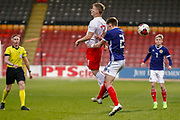 Jakub Gorski & Cameron Logan (Heat of Midlothian) challenge in the air during the U17 European Championships match between Scotland and Poland at Firhill Stadium, Maryhill, Scotland on 26 March 2019.