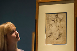 """© Licensed to London News Pictures. 28/02/2019. LONDON, UK. A staff member views """"The Anatomy of the Shoulder and Neck"""" c1510-11 by Leonardo da Vinci. Preview of """"The Renaissance Nude"""", an exhibition at the Royal Academy of Arts in Piccadilly of 90 works examining the emergence of the nude in European art.  Works by artists including Leonardo da Vinci to Michelangelo are on display in the Sackler Galleries 3 March to 2 June 2019.  Photo credit: Stephen Chung/LNP"""