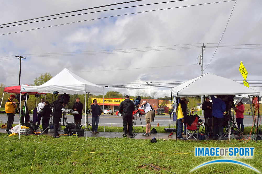 Media line the street across from the Waffle House on Murfreesboro Road on Monday, April 23, 2018 in Nashville, Tenn. where a shooting occurred on Sunday morning. Travis Reinking is the suspect in the shooting at the Waffle House restaurant Sunday in Nashville that resulted in the death of four people. Reinking is now in the custody of the Metro Nashville Police following a search lasting over 24 hours. (Jim Brown\IOS via AP)