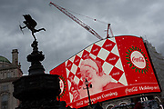 The Cocoa-Cola Christmas Santa ad appears on the digital screens that overlook Piccadilly Circus, on 22nd November 2019, in Westminster, London, England. Eros aka The Shaftesbury Memorial Fountain is located at the southeastern side of Piccadilly Circus in London, United Kingdom. Moved after World War II from its original position in the centre, it was erected in 1892–1893 to commemorate the philanthropic works of Lord Shaftesbury, who was a famous Victorian politician and philanthropist. The monument is surmounted by Alfred Gilberts winged nude statue generally, though mistakenly, known as Eros. This has been called Londons most famous work of sculpture.