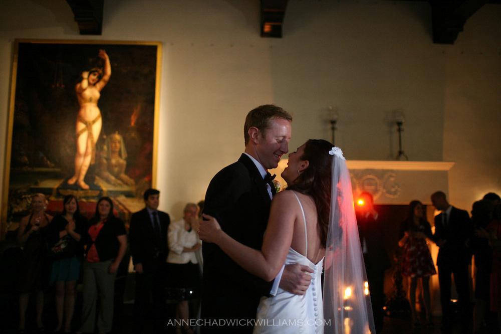 A bride and groom share a first dance at their reception at the Sutter Club in Sacramento, California.