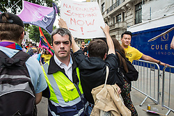 London, UK. 6 July, 2019. Activists from Lesbians and Gays Support The Migrants, African Rainbow Family, the Outside Project, Micro Rainbow and other LGBT+ groups break through a cordon formed in front of them by Pride in London stewards to join the rear of the march in solidarity with those for whom Pride in London is inaccessible and in protest against the corporatisation of Pride in London.