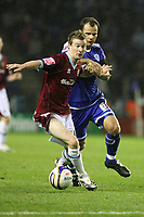 Photo: Pete Lorence/Sportsbeat Images.<br />Leicester City v Burnley. Coca Cola Championship. 10/11/2007.<br />Wade Elliot charges ahead of Stephen Clemence.
