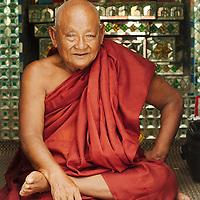 Buddhist monk smoking a cigar at Yangon pagoda