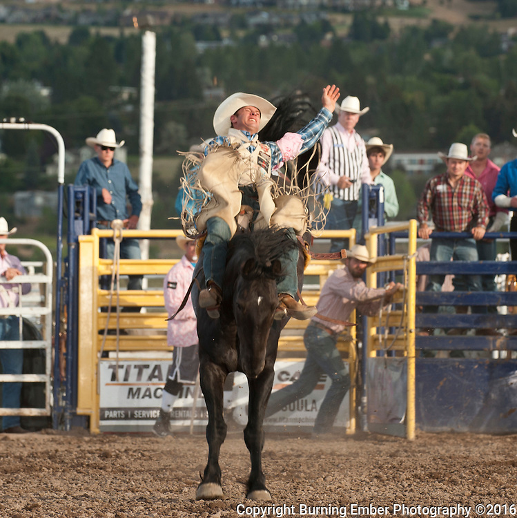 Chase Erickson rides for 82.5 points on Sankey Pro Rodeo bucking horse Right Spur at the Western Montana Fair PRCA Rodeo in Missoula MT August 12th 2016 2nd perf.  Josh Homer photo.  Photo credit must be given on all uses.  www.burningemberphotography.com