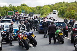 Tonbridge, UK. 6 May, 2019. Hundreds of motorcyclists taking part in the annual May Day Run wait on the A21 coastbound close to Tonbridge following a serious road traffic accident involving a motorcyclist. The road was closed in both directions for around five hours to facilitate attendance by an air ambulance to transport the seriously injured motorcyclist to a hospital in London.
