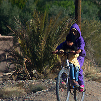 Africa, Morocco, Skoura. Moroccan Locals on bike near Skoura.