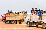 Peruvian schoolchildren on a field trip travel crowded in the back of trucks to historical Inca sites around the Sacred Valley.
