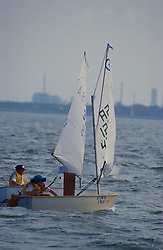 Stock photo of two sailboats sailing on the water