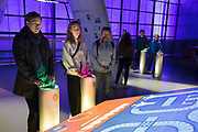 Engineer Your Future interactive exhibit for visitors to play interactive games at the Science Museum in London, England, United Kingdom. The Science Museum was founded in 1857 with objects shown at the Great Exhibition of 1851. Today the Museum is world renowned for its historic collections, awe-inspiring galleries and inspirational exhibitions.