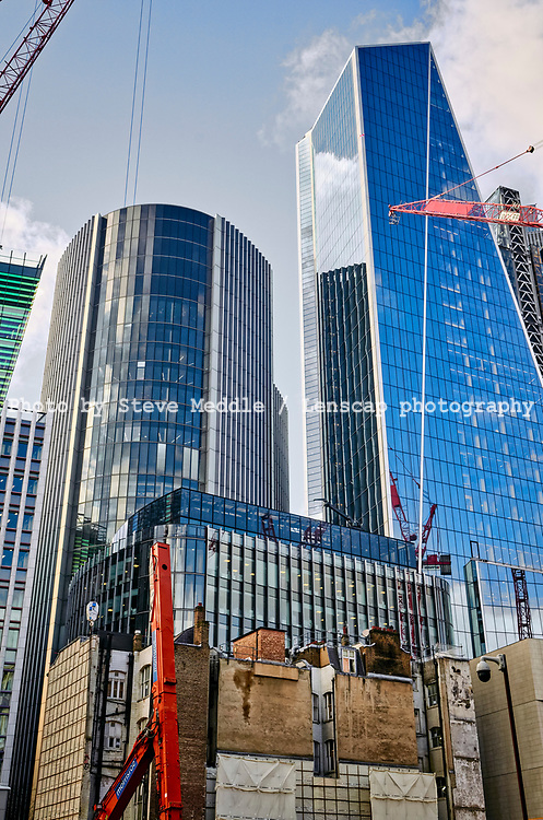 Construction work in Fenchurch Street showing The Willis building and Scalpel building,  London, England - 18 February 2021