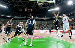Bostjan Nachbar of Efes vs Goran Jagodnik of Olimpija during basketball match between KK Union Olimpija (SLO) and Efes Pilsen (Tur) in Group D of Turkish Airlines Euroleague, on October 20, 2010 in SRC Stozice, Ljubljana, Slovenia. Union Olimpija defeated Efes Pilsen after 2 overtimes 95 - 90. (Photo By Vid Ponikvar / Sportida.com)