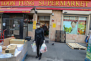 A customer wearing face protective mask and goggles is seen leaving the Loon Fung Chinese supermarket on Gerrard Street in London's Chinatown district, which does its Customers health checks before they allow them to enter facilities aiming to help curb the spread of Coronavirus outbreak, Monday, May 4, 2020. The disease has been detected in at least 187 countries and territories, with Italy, Iran, Spain and the US lately experiencing the most widespread outbreaks outside of China. In the UK, there have been 186,599 confirmed cases and 28,446 deaths until the 3rd of May. (Photo/ Vudi Xhymshiti)